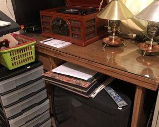 Glass top desk, old school TV, new Crosley turntable/radio, monitor