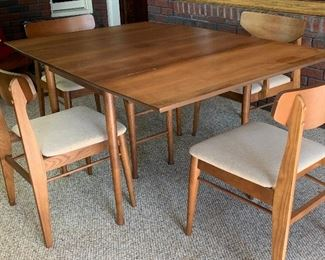 Mid-century dining table with 4 chairs. Excellent condition.