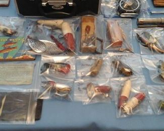 Vintage fishing lures,  Liar's License for fishing, fresh water fish guide book,  Morse code for flash light on lake.