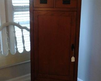 Mission style cabinet on a swivel base with full length mirror on the back. see next picture.