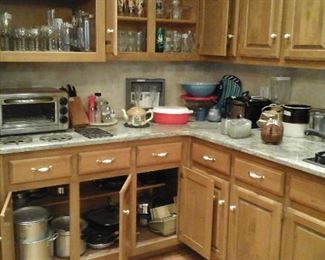toaster oven, vintage pyrex, pots and pans, baking pans and lots of kitchen stuff