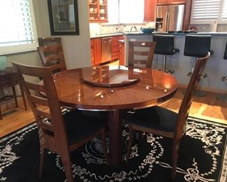 Leaves extend table to 8' round
