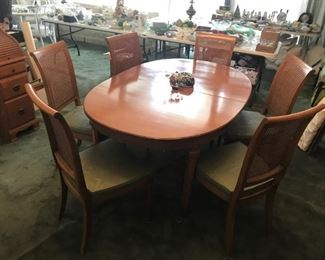 mid century dining table with 3 leaves and six caned chairs
