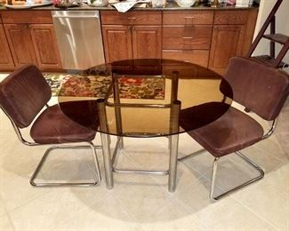 Smoked glass kitchen table and 3 chairs (one not shown)