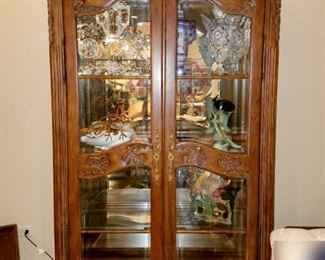 Pair of lighted china/curio cabinets that match a dining room table set