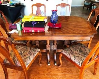 Gorgeous hardwood dining set with carved detailing