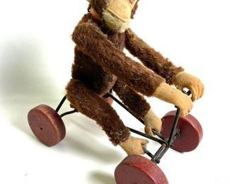 vintage Steiff monkey on bike pull toy