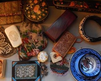 Display table with many boxes and china art.
