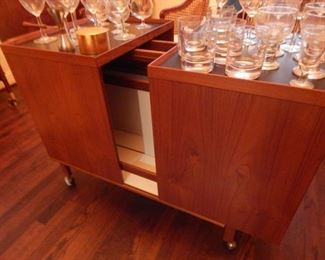 Mid Century bar on wheels. A great piece... you can float it in a room because it is finished on all sides.