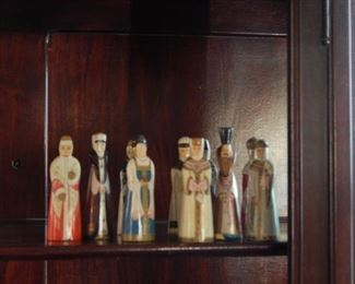 Cabinet figures, carved wooden and painted by hand.