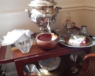 Samovar and other serving items on a mid century tea cart.