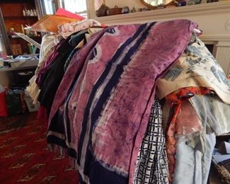 Lots of fabric and women's clothing.