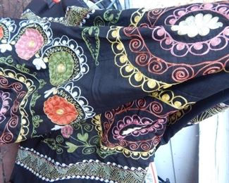 Asian bed coverlets, embroidered.