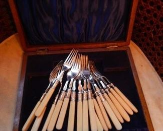 Silver forks with celluloid handles.