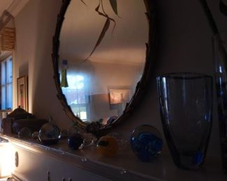 Round gold framed mirror, Paper weights and more.