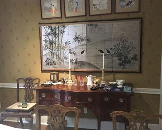 4 panel Asian screen, 19th century Sheraton style sideboard, miscellaneous bone china and tschotkes surrounded with reproduction Chippendale dining chairs with slip seats, part of a set of 8