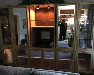 Mid-1980's mirrored wall/storage unit, lighted with retractable doors in 3 piece. possibly Thomasville or Henredon,  shown open.