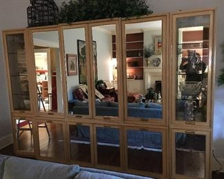 Mid-1980's mirrored wall/storage unit, lighted with retractable doors in 3 piece. possibly Thomasville or Henredon