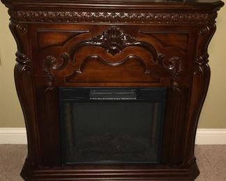 Cherry finish electric fireplace.