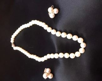Cultured pearls with 14 k clasp. Earrings are cultured pearls with diamonds and sterling silver post. Checked by Cravens jewelers in Georgetown KY.