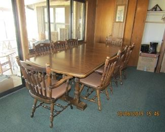 Large dinning room table with 8 chairs. Has two leaves in it, that can be removed to fit in a smaller area.