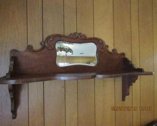 Wonderful wall shelve with beviled glass. Antique and original