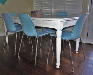 Rustic dining table with modern chairs