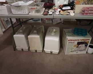 4 sewing machines and a sweater maker