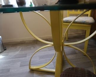 Vintage.  The cutest kitchen table with 4 chairs.  The base of the table is metal and chairs are wood.  It would be so cute repainted to match your house!