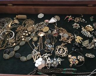 Packed cases of smalls and jewelry