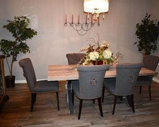 wood table and 6 upholsters chairs , iron work candelabra, 2 ficus trees and lighted  hutch and mirror