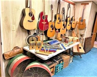 Many Acoustic Guitars and Musical Instruments including a Mini Harp