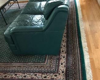 Pr of Green leathe couches from Toms Price and a beautiful like new Kaleen wool area rug