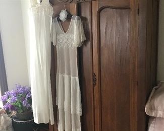 Impressive, this Classic Knock-down Wardrobe make a functional vintage accent piece and is easily broken-down to transport back to your home!  Notice the Vintage hand-made clothing!