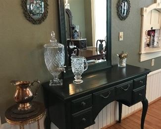 High in quality and dainty in design, this Thomasville Sideboard and Mirror ensemble looks classy In the dining room.