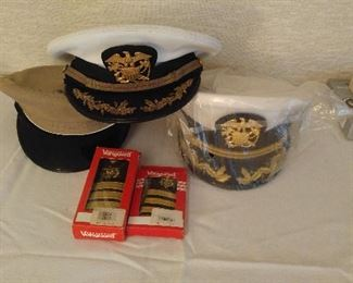 The doctor was in the navy. Shown are a Captain dress hat NEVER WORN and other hats and NIB epaulettes. Also the original RUSH ORDER bill is included.
