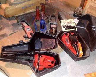 "TWO CHAIN SAWS (ONE 23"") AND 3 CAR JACKS"