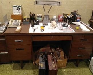 Office: nice desk, vintage lamp, great business cases, vintage phones