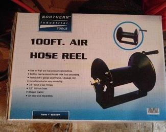 EXTRA AIR HOSE REEL  FOR COMPRESSOR. W/be sold Saturday