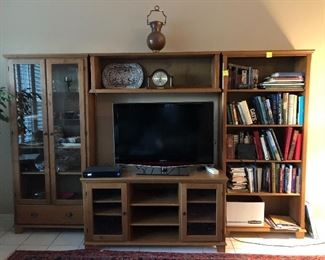 "IKEA entertainment center.   One of the nicer Ikea furniture pieces.  123""W X 76"" H X 13""D.   Four pieces sold together only."