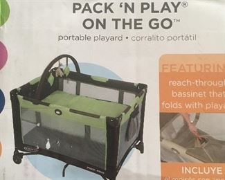 Pack n Play, green and brown, like new only used a few times, includes bassinet set