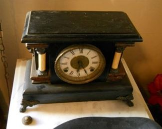 Rare vintage desk or mantel clock with marble and wood accents. Gold leaf frame around clock face.