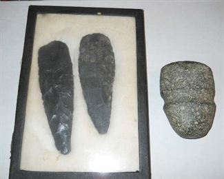 Historical Indian carved spears and stone artifacts
