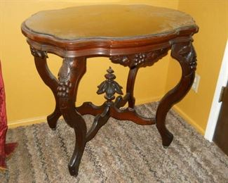 1920s Unique Intricate carved mahogany side table with glass top. 4' high