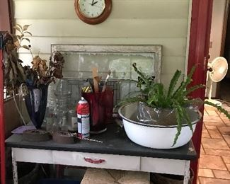 Potting table * wicker and wood stool * old windows * plants