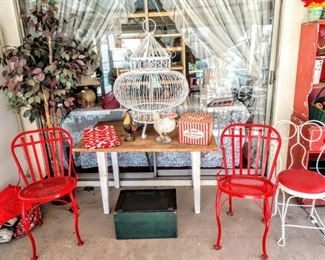 Solid iron red chairs, cute wood table top! Sides fold down to size of a sofa table