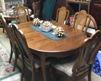 """Walnut dining room table with 6 chairs.  Table can open to 126"""" with leaves."""