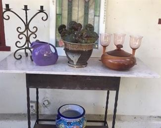 Fabulous outdoor console table, vintage stain glass window, wrought iron candelabra, wooden lidded bowl, Mexican cache pot, Fiestaware pitcher