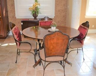 4 IRON CHAIRS AND RED DECORATIVE PILLOWS,  ROUND INLAID BANDED TABLE