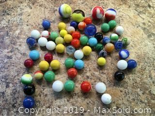 An assortment of vintage marbles